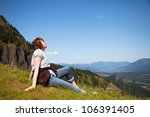 woman sits at the top of a...   Shutterstock . vector #106391405