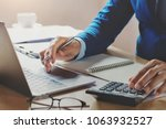 accountant working in office... | Shutterstock . vector #1063932527