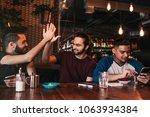 happy arabian young man giving... | Shutterstock . vector #1063934384