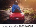 a boy dressed in a blue jacket... | Shutterstock . vector #1063944509