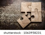 four wooden jigsaw puzzle... | Shutterstock . vector #1063958231