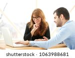 young financial assistant... | Shutterstock . vector #1063988681