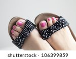 Closeup Of Feet Up A Girl With...