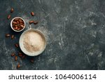 bowl of almond flour and bowl... | Shutterstock . vector #1064006114