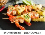 grilled shrimp skewers with... | Shutterstock . vector #1064009684