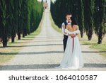happy stylish smiling couple... | Shutterstock . vector #1064010587