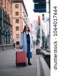 happy smiling tourist girl... | Shutterstock . vector #1064017664