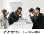 stressed multiracial team... | Shutterstock . vector #1064028881