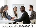 smiling african businessman in... | Shutterstock . vector #1064028911