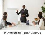 confident african speaker... | Shutterstock . vector #1064028971