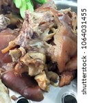 """Small photo of Stewed pork leg """"Khao Kha Moo"""" with vegetable on top prepare for serving with Egg and Rice at roadside restaurant, Thai street food."""