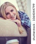happy girl online browsing a...   Shutterstock . vector #1064044799