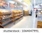 blurred supermarket store... | Shutterstock . vector #1064047991