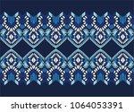 ikat geometric folklore... | Shutterstock .eps vector #1064053391