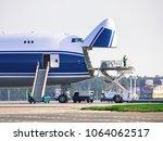 loading cargo into the cargo... | Shutterstock . vector #1064062517