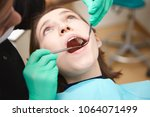 cropped shot of dentist or... | Shutterstock . vector #1064071499