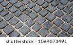 stone block road pavement | Shutterstock . vector #1064073491