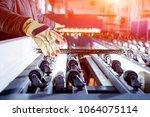 conveyor belt for production a... | Shutterstock . vector #1064075114