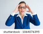 irritated tired young... | Shutterstock . vector #1064076395
