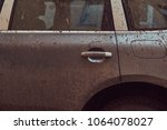 close up image of a dirty car... | Shutterstock . vector #1064078027