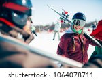 skiers with skis and poles ... | Shutterstock . vector #1064078711