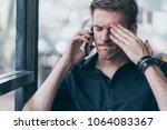 stressful white man caucasian... | Shutterstock . vector #1064083367