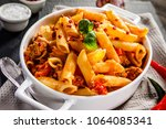 penne with meat  tomato sauce... | Shutterstock . vector #1064085341