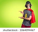 superhero monkey man pointing... | Shutterstock . vector #1064094467