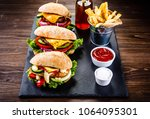 tasty cheeseburgers with french ... | Shutterstock . vector #1064095301