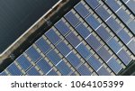 aerial top down photo of solar... | Shutterstock . vector #1064105399