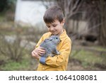 cute little preschool boy ... | Shutterstock . vector #1064108081
