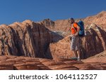 hiker on a trail in volcanic... | Shutterstock . vector #1064112527