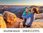 a mother with baby son in grand ... | Shutterstock . vector #1064112551