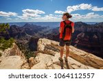a hiker in the grand canyon... | Shutterstock . vector #1064112557