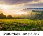 gorgeous foggy sunrise in... | Shutterstock . vector #1064113019