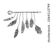 hand drawn arrow with feathers... | Shutterstock .eps vector #1064113799