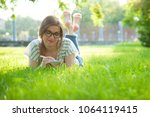 charming young woman writing in ... | Shutterstock . vector #1064119415