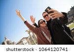 happy young couple making... | Shutterstock . vector #1064120741