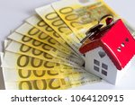 a lot of euro  key and house on ... | Shutterstock . vector #1064120915