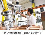 young mechanical engineering... | Shutterstock . vector #1064124947
