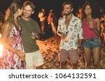 happy friends drinking beer at... | Shutterstock . vector #1064132591