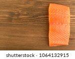 salmon fillet on wooden...   Shutterstock . vector #1064132915