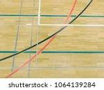 wooden floor in sporting hall...   Shutterstock . vector #1064139284