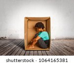 sad black woman inside a box on ... | Shutterstock . vector #1064165381