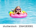happy child on inflatable ice... | Shutterstock . vector #1064183081