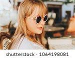 outdoor close up portrait of... | Shutterstock . vector #1064198081