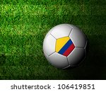 Colombia Flag Pattern 3d rendering of a soccer ball in green grass - stock photo
