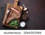 grilled cowboy beef steak ... | Shutterstock . vector #1064201984