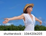 happy young woman wearing brown ... | Shutterstock . vector #1064206205
