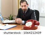 anxious businessman waiting for ... | Shutterstock . vector #1064212439